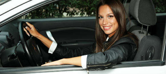a young woman smiling beautifully on her car rental