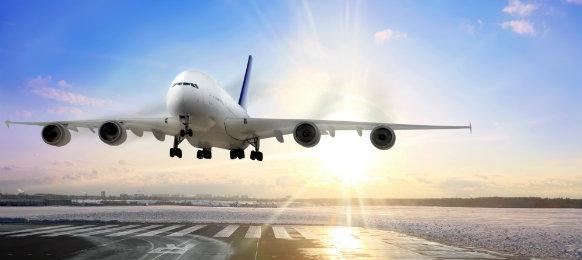 airplane landing on runway in airport