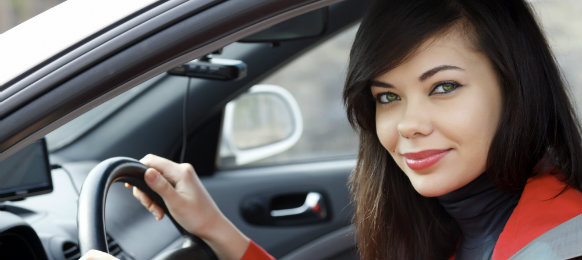 A gorgeous woman inside the car