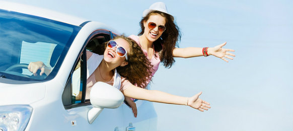 cheerful girls enjoying the roadtrip