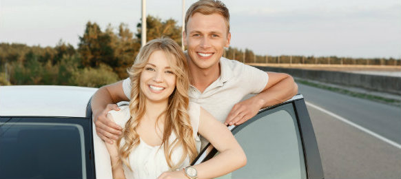 lovely couple posing near their white car