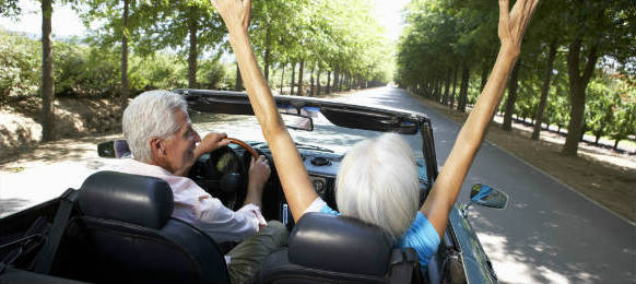 grandparents in a roadtrip using a convertible car rental