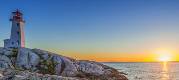 Peggys Cove Lighthouse at sunset in Nova Scotia, Canada