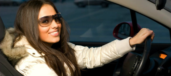 stylish woman driving her car