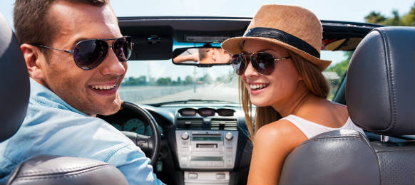 traveling couple in a convertible car rental