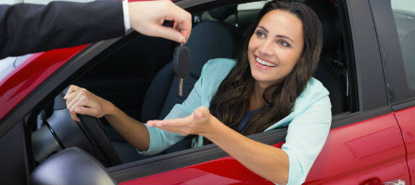 A happy lady receiving her car key